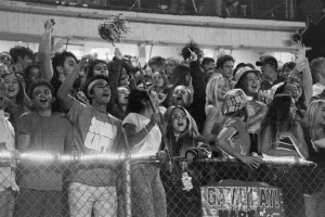 """Leading the cheer: The Student Section Suppports the team by chanthing their """"I believe"""" chant at the football game against Mt. Carmel on Oct. 11. Student section leaders Marquez White and Sydney Kallman(Left) lead the Titan cheer to support the football team."""