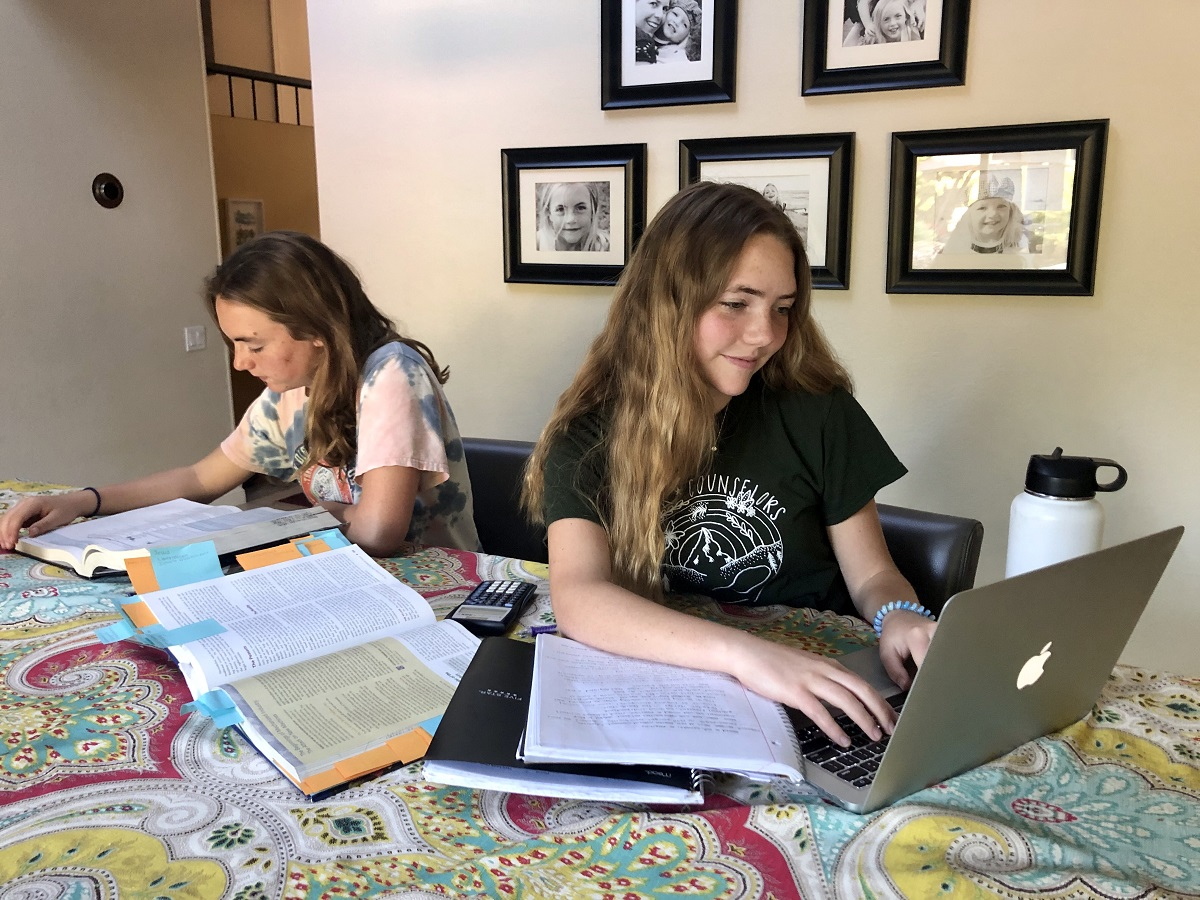 Titans work on assignments from home.