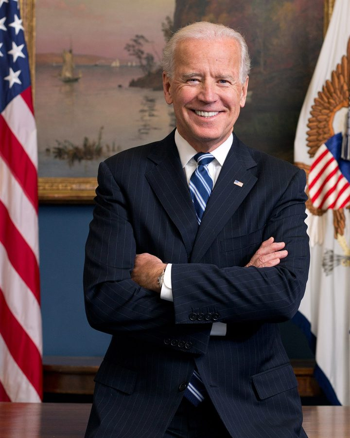 Joe Biden stands next to the American Flag for his official 2013 portrait. He smiles proudly, hoping to represent our country after this election.