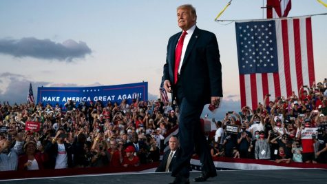 Trump walks out of his aircraft into his abundant crowd of supporters for his first rally after coronavirus.