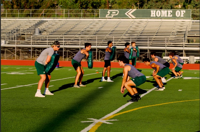 Varsity football players practicing drills. The students are preparing for the upcoming season. (Demi Smith)