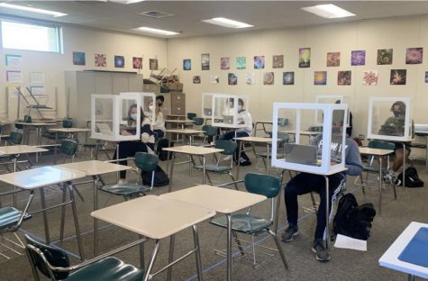 "The back to school plan would have masked students placed at a desk within a plexiglass box that is at least six feet away from other students. The new look of our classrooms will likely be in place once it is ""safe"" to go back to school."