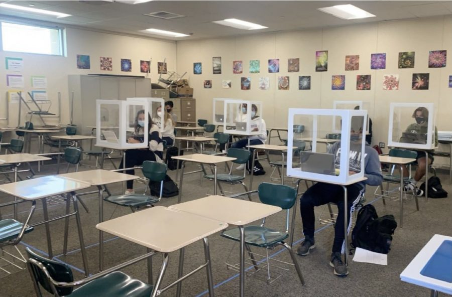 The back to school plan would have masked students placed at a desk within a plexiglass box that is at least six feet away from other students. The new look of our classrooms will likely be in place once it is