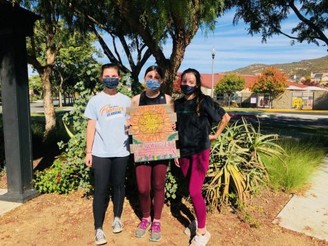 Lauren Binda (left), Quinn Flood (middle), and Nathalie Geffroy (right) volunteering at the Monterey Elementary School gardens.