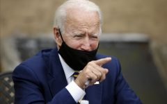 Biden wears his mask under his nose while giving a speech