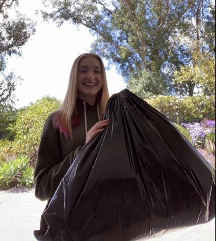 Senior APES students Camden Pomeranz holds up her bag of trash.