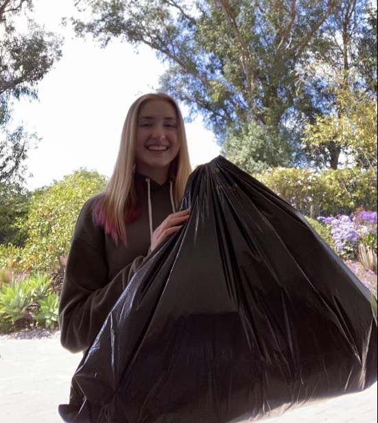 Senior+APES+students+Camden+Pomeranz+holds+up+her+bag+of+trash.+