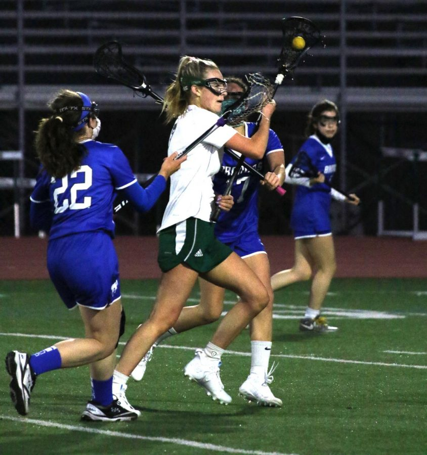 Senior Erin Steinhour carries the ball through a horde of defenders looking to score